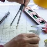 l-ingegneria-usa-l-attrezzatura-per-fare-il-disegno-del-progetto-di-costruzione_41466-415